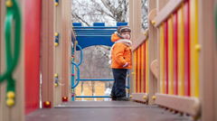 Little boy on playground equipment Stock Footage