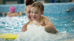 Grandmother and a grandson in the swimming pool Stock Footage