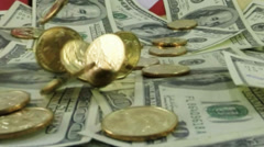 US currency gold coins falling in slow motion Stock Footage