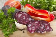 Stock Photo of summer sausage with fat incorporation served with vegetables