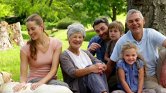 Stock Video Footage of Extended family smiling at the camera in the park