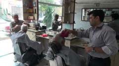 Iran, barber, cutting hair, trimming beard, saloon, Middle East Stock Footage