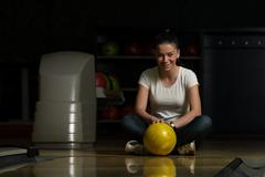 Cheerful young women holding bowling ball Stock Photos