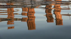 Reflection of 'badgirs', wind catching towers, in water of pool in Iran Stock Footage