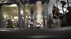 prosthetic recipient on treadmill low angle rear view - stock footage