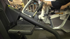 prosthetic recipient on recumbent bike side and top view - stock footage