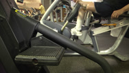 Stock Video Footage of prosthetic recipient on recumbent bike side and top view