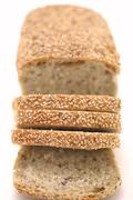 Loaf of sliced multigrain bread  Stock Photos