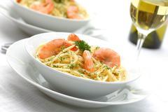 Pasta primavera with grilled shrimps  - stock photo