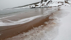 A cold and icy winter shoreline Stock Footage