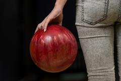 close-up of a butt next to a bowling ball - stock photo