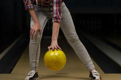 beginner aiming to bowling pins - stock photo