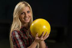 women holding a bowling ball - stock photo