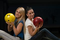 Cheerful young couple holding bowling ball Stock Photos