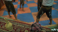 Zurkhaneh, feet and legs of men warming up for performance Stock Footage