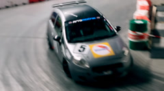 Close up on car racing indoors Stock Footage