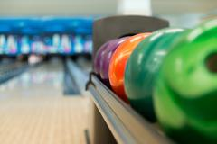 Rack of colorful balls at a bowling alley Stock Photos