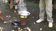 Stock Video Footage of Man preparing coffee in pan on fire. Arusha coffee plantation, Tanzania, Africa