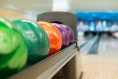 rack of colorful balls at a bowling alley - stock photo
