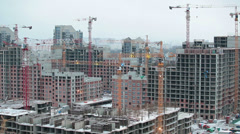 Construction site covered with snow. Stopped cranes and machinery Stock Footage