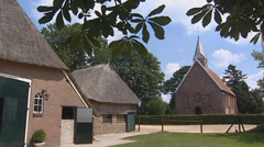 Zweelo ancient Church behind farmyard pan saxon farmhouse. Stock Footage