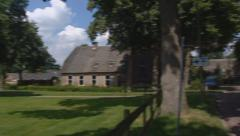 Saxon farmhouse pan rural village, street + traffic, Drenthe, The Netherlands. Stock Footage