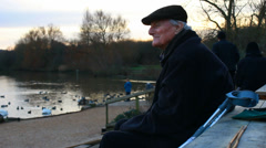 Elderly man at nature reserve looks into camera Stock Footage