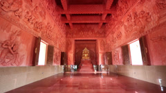Buddhist temple inside red dolly Stock Footage
