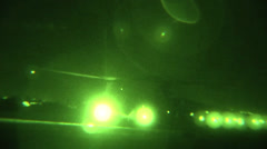 CH-47F Chinooks pick up sling loads at night Stock Footage