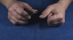Detail Of Two Hands Nail Clipping Front-Shot Stock Footage