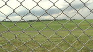 Stock Video Footage of chain link fence WS
