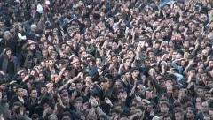 Crowds of men mourn the martyrdom of Hussein, during Ashura in Iran Stock Footage