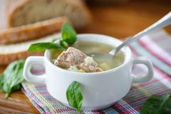 Soup with meat and noodles Stock Photos