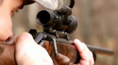 Hunter with rifle shoot Stock Footage