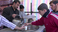 Stock Video Footage of Iran, pouring hot milk for free during religious event Ashura