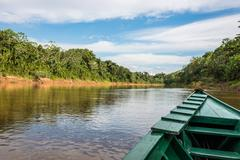 Boat in the river in the peruvian amazon jungle at madre de dios peru Stock Photos