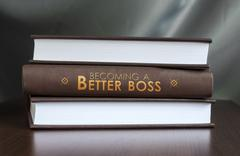 Becoming a better boss. book concept. Stock Photos
