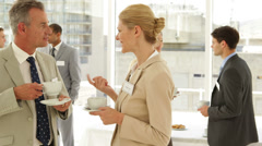 Business people chatting at a conference - stock footage