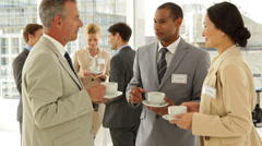 Business people chatting at a conference having coffee Stock Footage