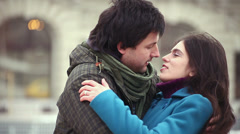 Valentines affectionate young adult man embraces young adult woman Stock Footage