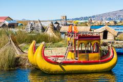 uros floating islands peruvian andes puno peru - stock photo