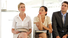 Business people waiting for an interview Stock Footage