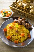 Arab rice, rice with meat and carrot in a bowl. middle eastern food. Stock Photos