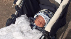 Newborn Baby asleep in pushchair 2 Stock Footage