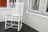 Stock Photo of White rocking chair on porch