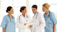 Medical team discussing a file Stock Footage
