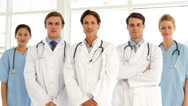 Confident medical team looking at camera and giving thumbs up Stock Footage