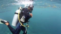 Scuba diver commences dive and descends Stock Footage