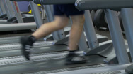 Stock Video Footage of Lower half view of man running on treadmill