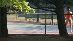 Girl playing tennis Stock Footage